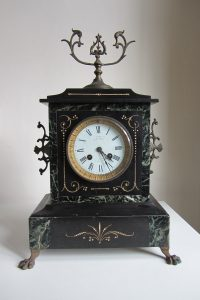 french mantel clock with black marble design