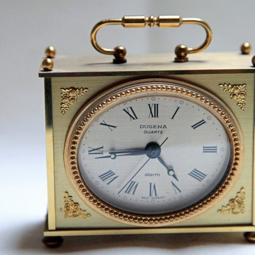 small quartz metallic clock